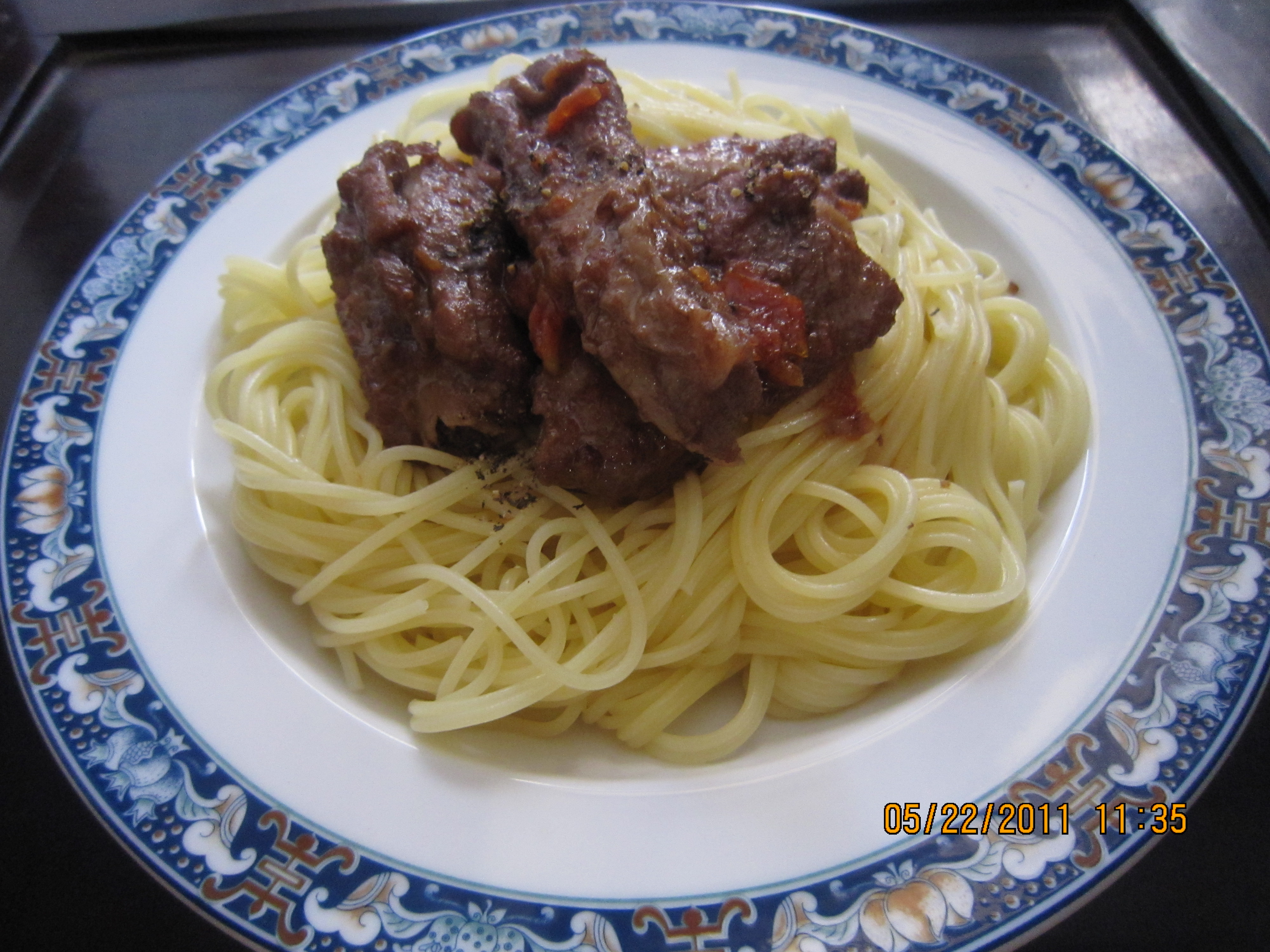 Angel hair pasta with ribs cooked in tomato and red wine ...
